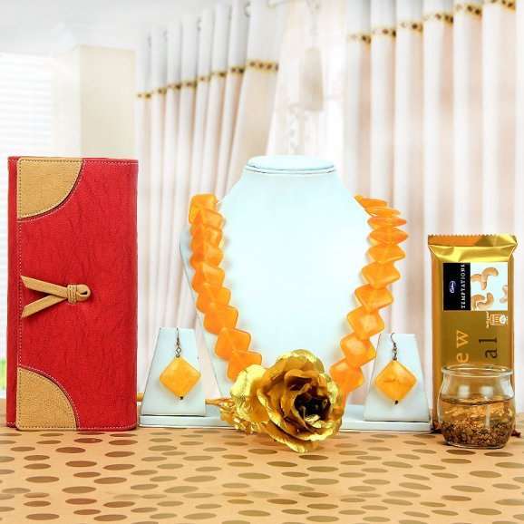 clutch and necklace alongwith candle and temptation
