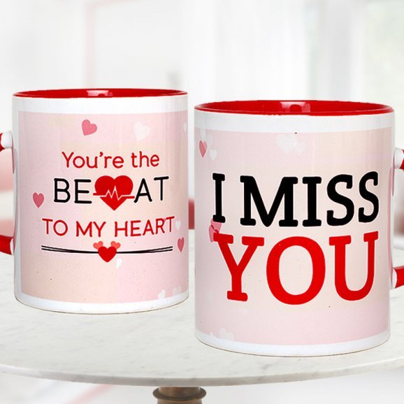 A combo of 6 inches pink and white Kitty An I Miss You Mug and A golden Rose
