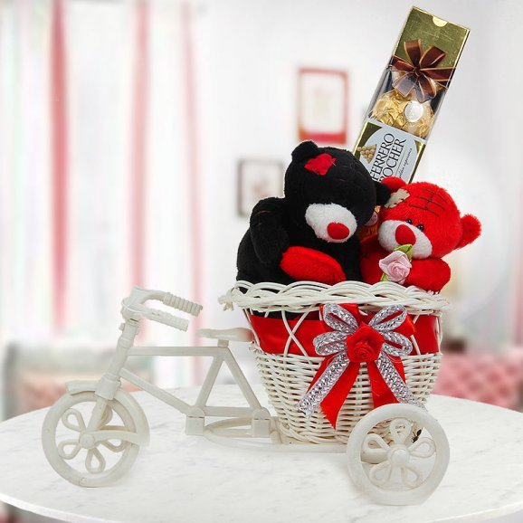 A combo of 2 teddies a pack of 4 Ferrero Rocher and an adorable miniature cycle