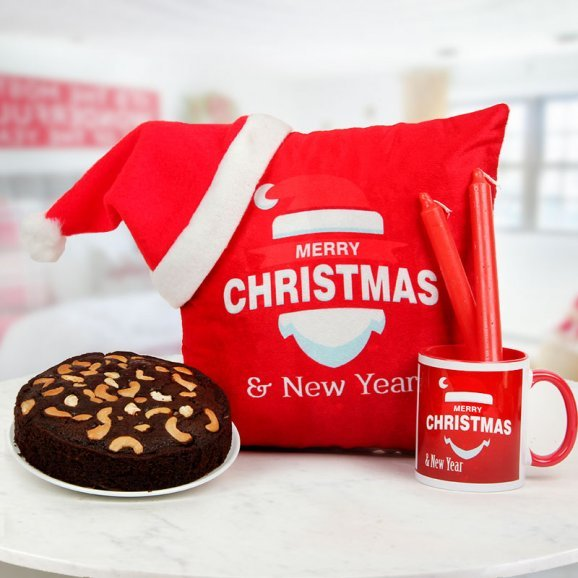 Combo consisting of a delicious 1/2 kg plum cake, a 12x12 inches digitally printed Red Cushion and 2 Christmas candles