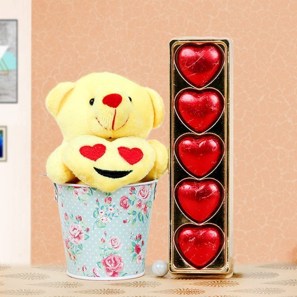 A yellow teddy and chocolates gift