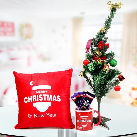 Combo consists of a 12x12 inches brilliantly red cushion, a 2 feet miniature Christmas tree, 5 Dairy milk and a Merry Christmas Coffee Mug