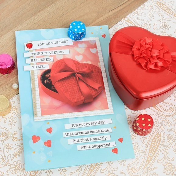A combo of greeting card and handmade chocolates in a heart shaped tin box