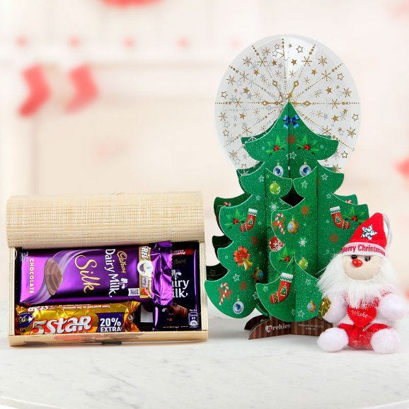 Adorable little Santa, 2 Dairy Milk, 1 Dairy Milk Silk, 1 Five Star and 1 Temptation along with an Archies Christmas Tree card
