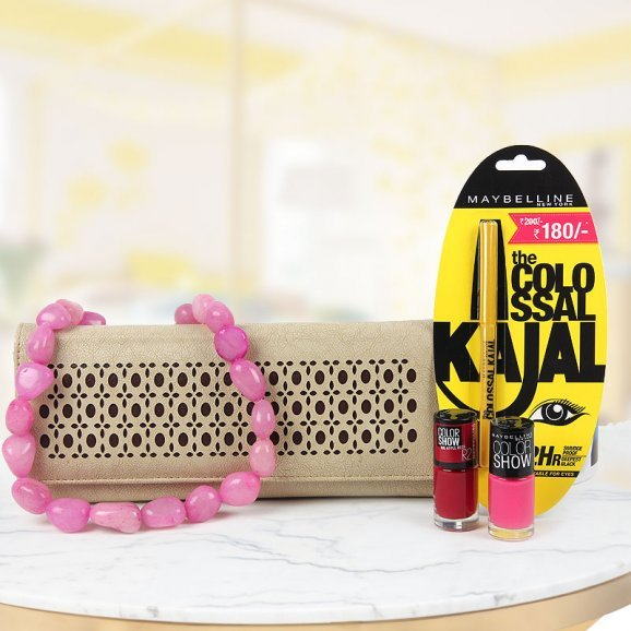 Stylish clutch with beaded neckpiece and Maybelline kajal and nailpaint