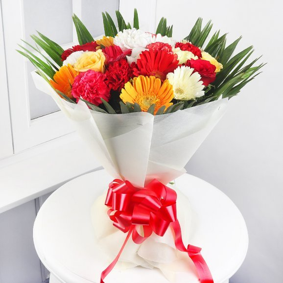 9 Mixed Carnations 4 Red & Yellow Roses and 9 Mixed Gerberas