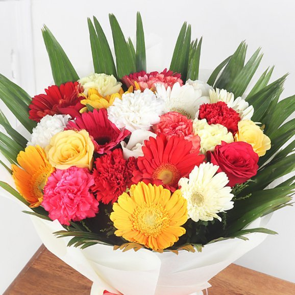 9 Mixed Carnations 4 Red & Yellow Roses and 9 Mixed Gerberas with Zoomed in View