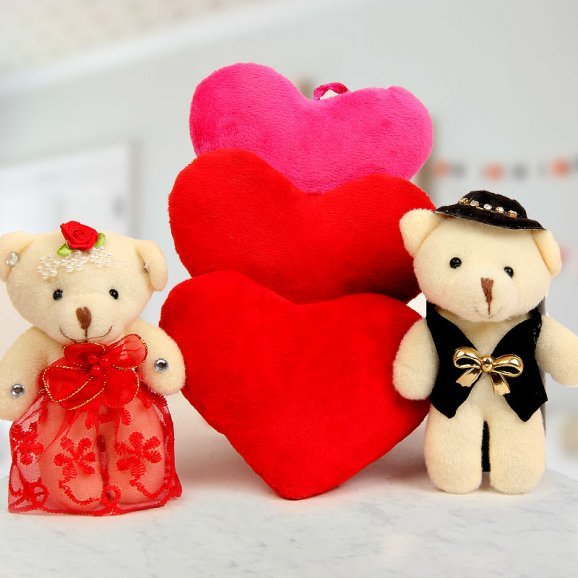 A pair of 3 inch teddy bears and Three colorful hanging hearts