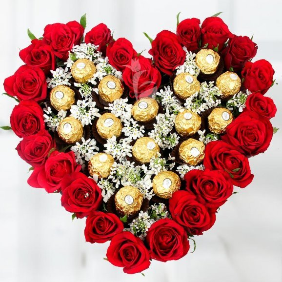 A 25 Red Roses in a heart-shaped with 16 Ferrero Rocher chocolates