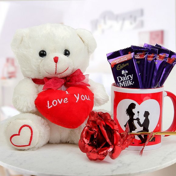 A 6 inch I Love You teddy A beautiful red rose A coffee mug and four Dairy Milk chocolates