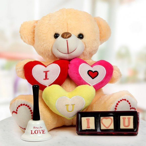 A 14 inches I love you Teddy A pack of handmade chocolates and A Ring For Love bell