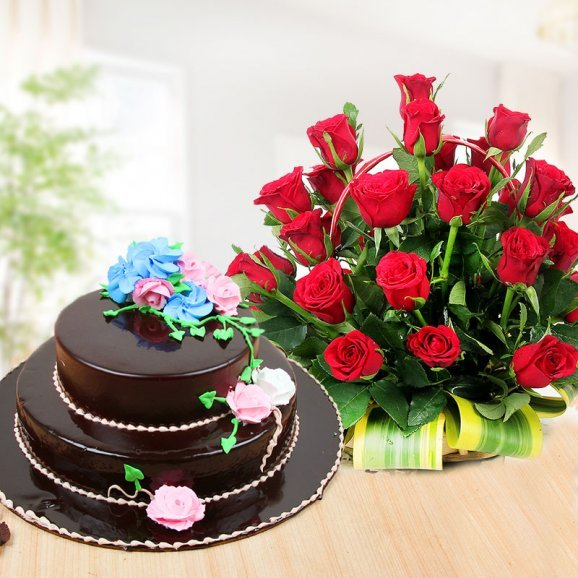 Party Essentials - A combo of 2 tier chocolate cake and 40 red roses in basket