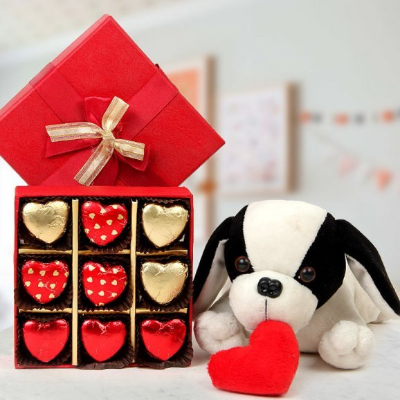 A box of 9 heart-shaped handmade chocolates A 10 inch soft toy puppy with heart