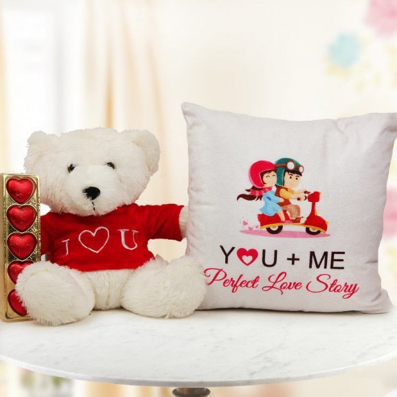 A 8 inches Teddy A pack of heart shaped handmade chocolates and A 12x12 inches Perfect Story Cushion
