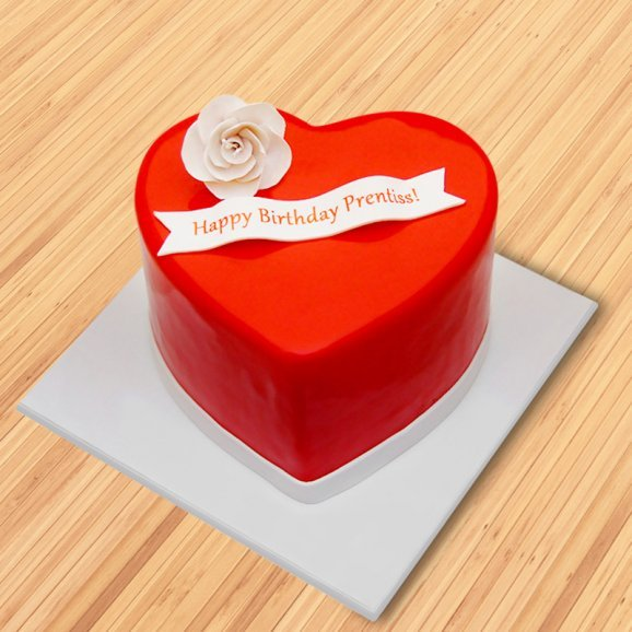 Heart shaped birthday cake with a rose