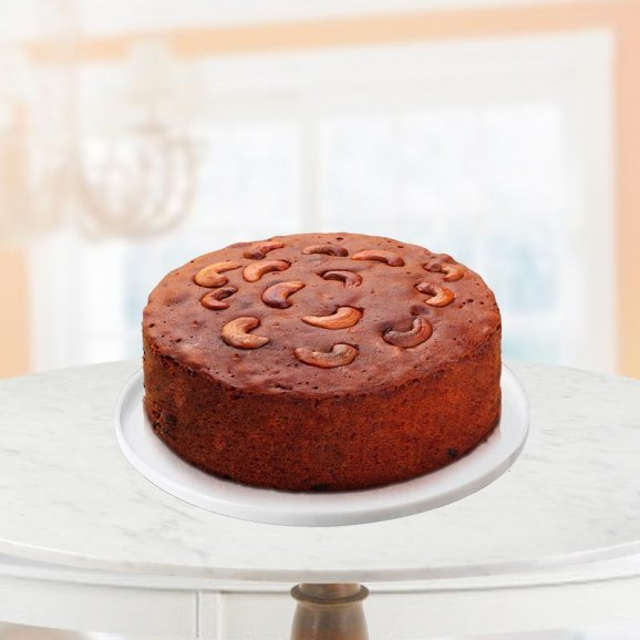 relishable plum cake with dry fruit on it