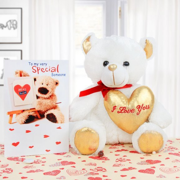 A white teddy and a card combo
