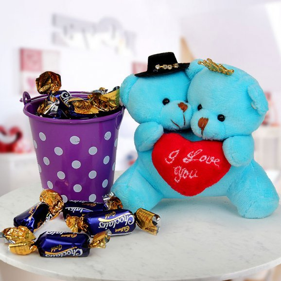 A pair of 3 inches joined I Love You Teddy and A little bucket of chocolaty Eclairs Gold