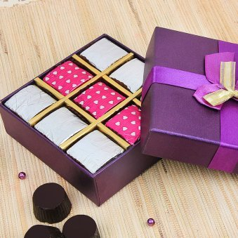 9 handmade chocolates packed in a box