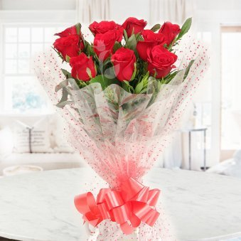 Front view of 10 red roses bouquet - A product of Delectable Symphony Combo