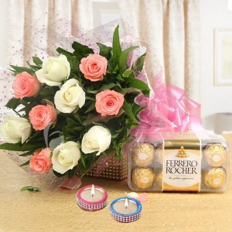 A Nectarous Delight - Combo of 10 white and red roses bouquet with 16 Ferrero Rocher chocolates and Diyas
