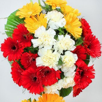 20 Red Gerberas 15 White Carnations and 15 Yellow Gerberas in Arrangement in Zoomed View
