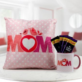 A combo of Mom printed cushion with mug and 5 Dairy Milk chocolate for mother