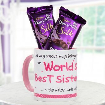 "Combo of ""World's Best Sister"" quoted ceremic coffee mug with two Cadbury Dairy Milk silk chocolate"