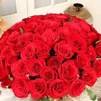 Bunch of 50 beautifully wrapped roses with Top View