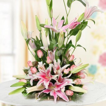 An arrangement of 4 Pink Lilies and 12 Pink Roses