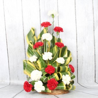 A basket of red and white carnations