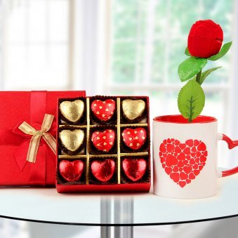 A box of heart shaped handmade chocolates A beautiful coffee mug and A rose shaped ring box