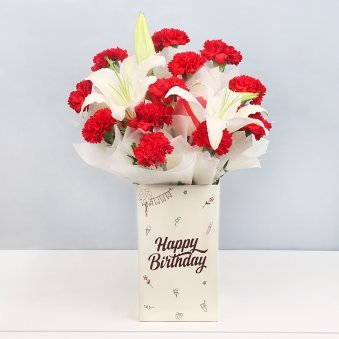 12 Red Carnations and 2 Lilies in Birthday Box with Closed View
