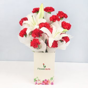 12 Red Carnations and 2 Lilies in Floweraura Box