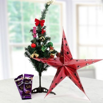 A beautifully Ornamented Christmas tree with 2 Cadbury DairyMilk Silk Chocolates and a Lovely Decoration Star