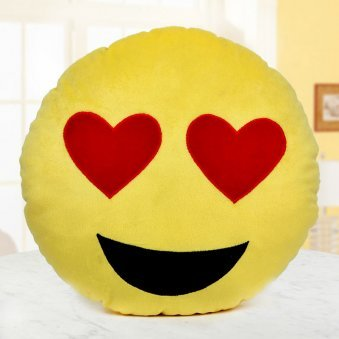 A smiling face with heart eyes pillow