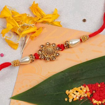 Golden Fancy Rakhi with Roli Tikka