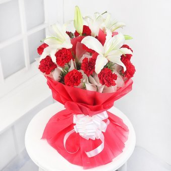 15 Red Carnations and 4 Oriental White Lilies