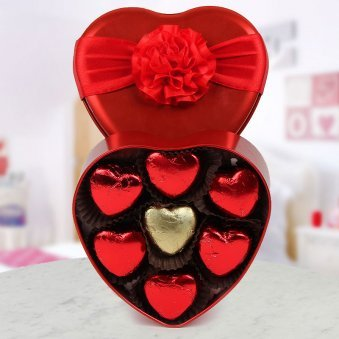 A beautiful heart shaped box full of heart-shaped handmade chocolate