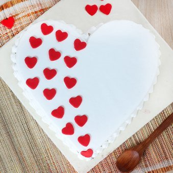 Heart Shaped Vanilla Cake With Hearts On It - Top View