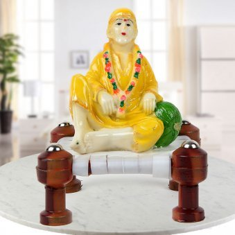 Spritual Master Sai Baba on Chowki in Yellow Clothes