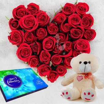 30 Red roses hearshaped 12 inches cream colored teddy cadbury celebation