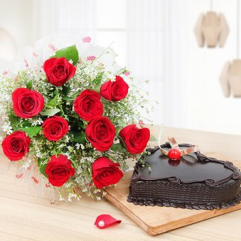 Surprising Heartilicious Combo - 10 Red roses with 1 kg heart shaped chocolate cake