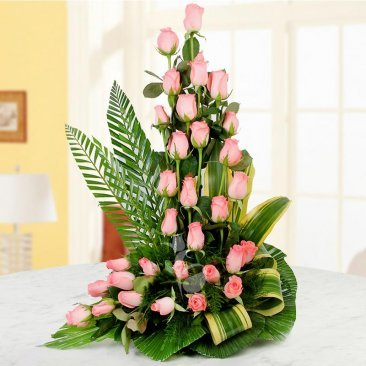 A tall arrangement of 30 Pink roses