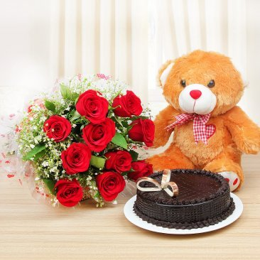 Endearingly Yours - Half kg Chocolate cake and 10 red roses with a brown teddy