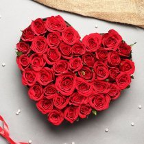 Basket of 35 Red Roses packed beautifully in the shape of heart
